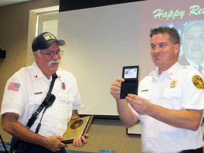 RHIL GETTING HIS RETIREMENT ID CARD AND LT BADGE CASE