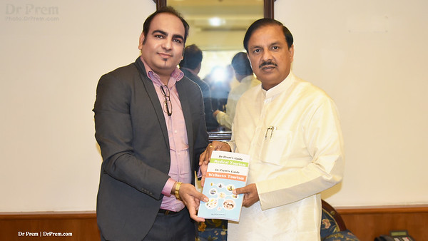 Dr Prem Jagyasi with Honourable Minister of Culture and Tourism of India - Dr Mahesh Sharma, presenting guide books and discussing Medical Tourism and Wellness Tourism