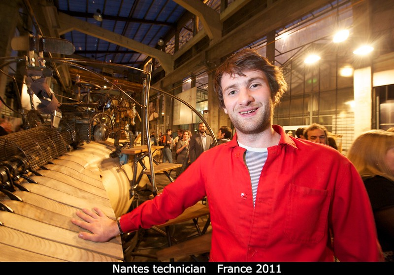 """One of the Frenchman who runs the workshop. As if to clarify his role, he tells me """"I am merely a magician. I join the machines, to the people. But I do not create them in my mind. This is a crankshaft, which drives the squid. May I show it to you?""""<br /> <br /> Credit: Henry Throop<br /> Oct 2011"""