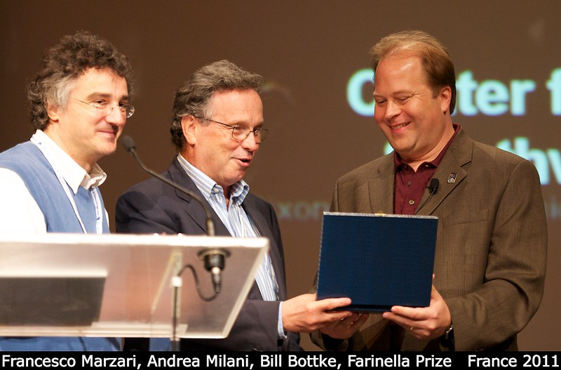 Francesco Marzari and Andrea Milani give Bill Bottke the 2011 Paolo Farinella Prize.<br /> <br /> Credit: Henry Throop<br /> Oct 2011