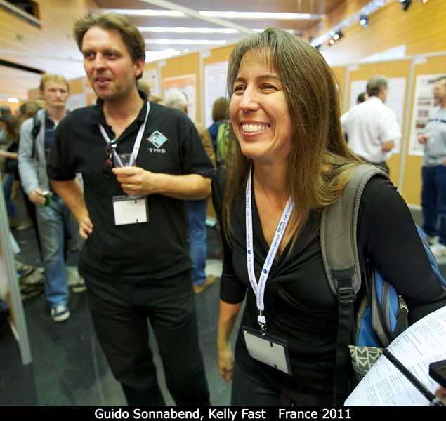 "Guido Sonnabend (U. Cologne) and Kelly Fast (HQ /GSFC).<p> Me: You look familiar -- I think we've met at, uh. . .</p><p>Kelly: [Mentions a dozen labs and conferences I've never heard of.]</p><p>Me: Hmm, no, no . . .</p><p>Kelly: Oh! Uh, maybe YouTube? <a href=""http://www.youtube.com/watch?v=XPdTlHK1h_0"">Hotel Mauna Kea</a>?</p><p>Me: Ahhhhh!</p>  Credit: Henry Throop Oct 2011"