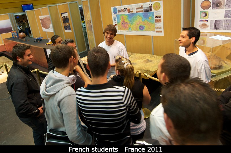 Downstairs, bunches of French students visit a very large solar system exhibit set up.<br /> <br /> Credit: Henry Throop<br /> Oct 2011