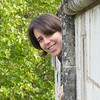 Alyssa Rhoden (Berkeley, but soon GSFC) inspects gargoyles on the Nantes castle ramparts.<br /> <br /> Credit: Henry Throop<br /> Oct 2011