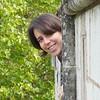 Alyssa Rhoden (Berkeley, but soon GSFC) inspects gargoyles on the Nantes castle ramparts.<br /> <br /> Credit: Henry Throop<br /> Oct 2011