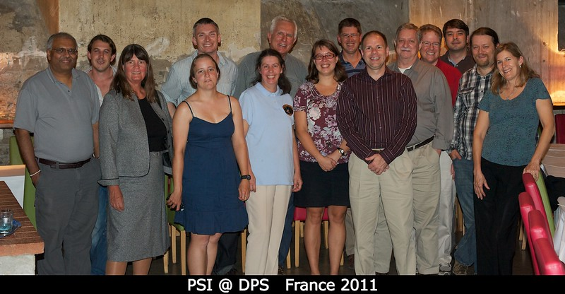 The PSI crowd at DPS. L-R: Nanin Samarasinha, Joe Michalski, Candy Hansen, Susan Conway, Henry Throop, Bea Muller, Bill Hartmann, Julie Rathbun, Tyler Nordgren, Paul Abell, Keith Holsapple, Jeff Morgenthaler, Pasquale Tricarico, Tommy Grav, Carol Raymond (JPL)<p>Not seen: Faith Vilas, Tom Prettyman.</p><p>Dave O'Brien would have made it, but he was off riding his bike 508 miles through the desert.</p>  Credit: Henry Throop Oct 2011