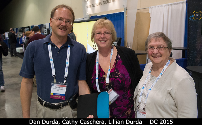 Dan Durda has brought his sister Cathy Caschera and mom Lillian Durda for some thrilling poster-session action.<br /> <br /> Credit: Henry Throop<br /> Oct 2015<br /> DPS47 National Harbor