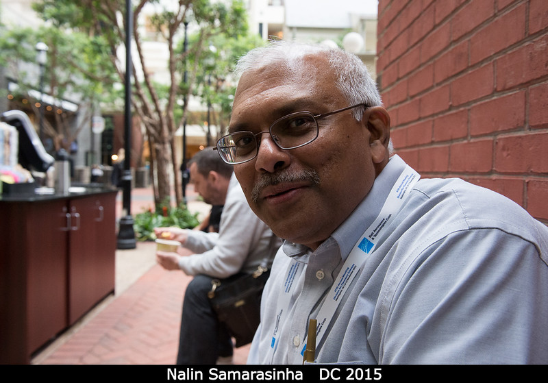 Nalin Samarasinha (PSI) hopes for a comet to come crashing through the gigantic glass atrium we're all sitting under.<br /> <br /> Credit: Henry Throop<br /> Oct 2015<br /> DPS47 National Harbor