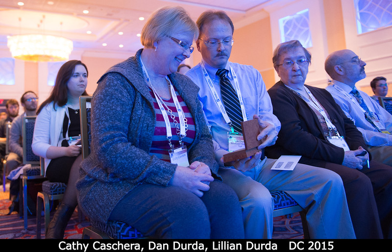 Dan Durda's sister Cathy and mom Lillian are sufficiently impressed with that hefty Sagan medal!<br /> <br /> Credit: Henry Throop<br /> Oct 2015<br /> DPS47 National Harbor