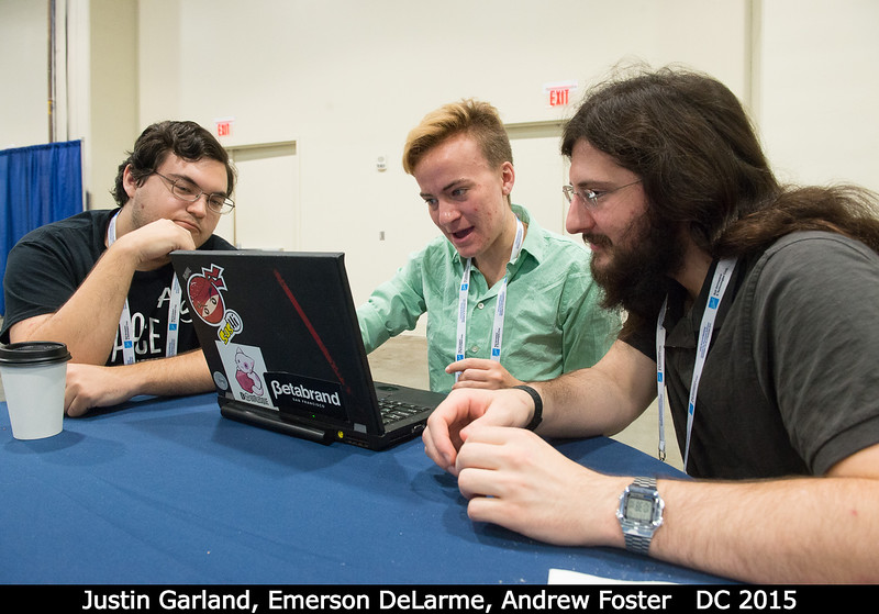 Justin Garland, Emerson DeLarme, and Andrew Foster (all UCF) discuss something awesome.<br /> <br /> Credit: Henry Throop<br /> Oct 2015<br /> DPS47 National Harbor