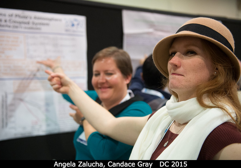 Angela Zalucha's poster gets a bit of critical eye from Candace Gray.<br /> <br /> Credit: Henry Throop<br /> Oct 2015<br /> DPS47 National Harbor