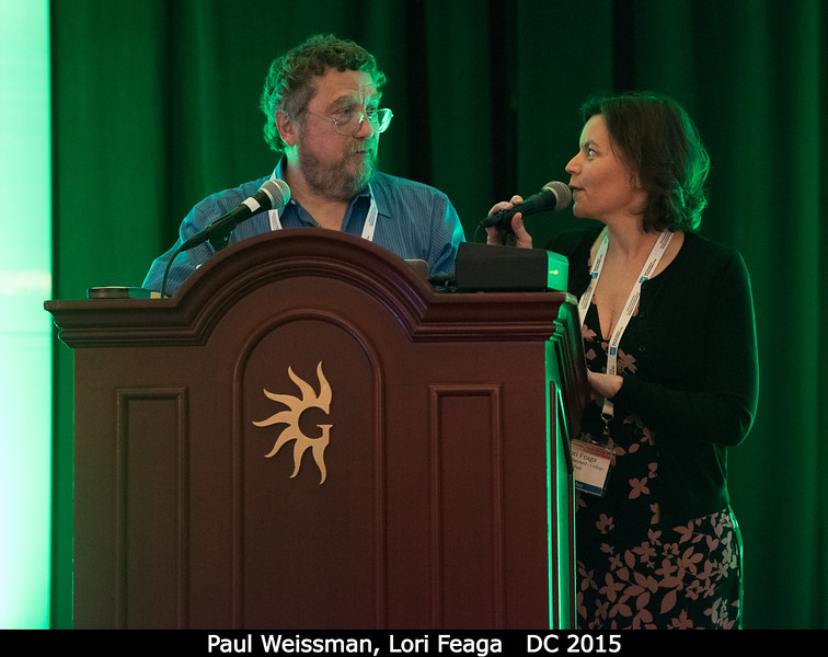 Paul Weissman (PSI) and Lori Feaga (UMD) debate who should give the next plenary. <br /> <br /> Credit: Henry Throop<br /> Oct 2015<br /> DPS47 National Harbor