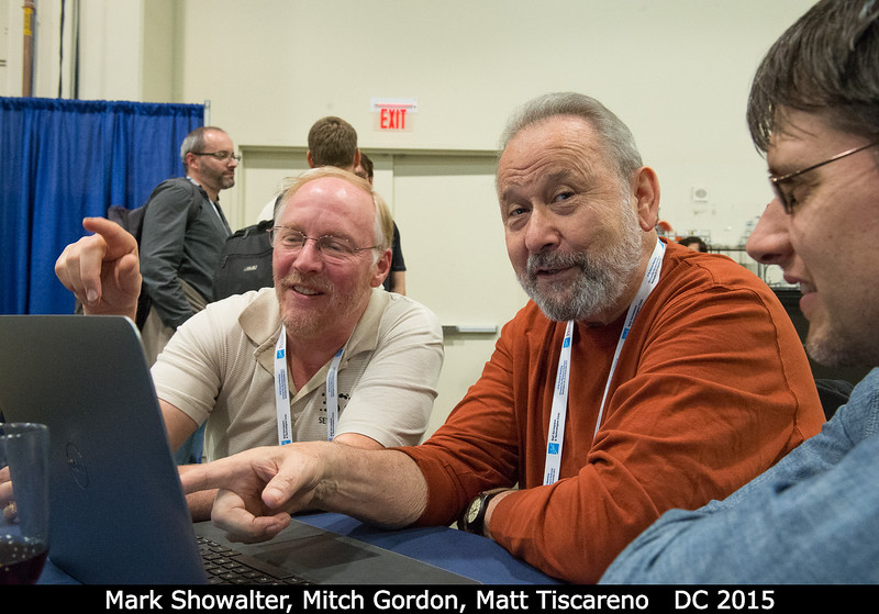 """Mark Showalter and Mitch Gordon point as Matt Tiscareno observes. Mark: 'But if you had a 27"""" screen on your laptop, those rings particles would be right up here!'<br /> <br /> Credit: Henry Throop<br /> Oct 2015<br /> DPS47 National Harbor"""