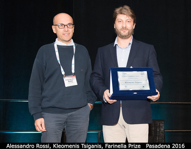 Alessandro Rossi (IFAC-CNR) presents the Paolo Farinella prize to Kleomenis Tsiganis (Aristotle University of Thessaloniki). <br /> <br /> Credit: Henry Throop<br /> Oct 2016<br /> DPS48 Pasadena