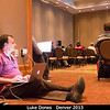 Luke Dones (SwRI) is a connected man.<br /> <br /> Credit: Henry Throop<br /> Oct 2013<br /> DPS45 Denver