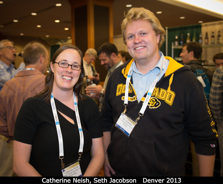 Catherine Neish (FIT) and Seth Jacobson.<br /> <br /> Yes, that's beer in the background, but no open bar here!<br /> <br /> Credit: Henry Throop<br /> Oct 2013<br /> DPS45 Denver