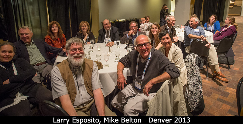 Watching the photo show at the banquet... Larry Esposito and Mike Belton in front, surrounded by other famous luminaries.<br /> <br /> Credit: Henry Throop<br /> Oct 2013<br /> DPS45 Denver