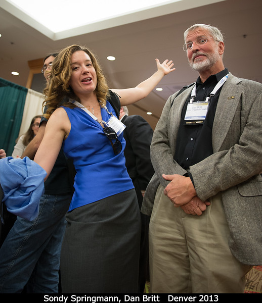 Alessondra Springmann (Arecibo) dances while Dan Britt is transfixed by something.<br /> <br /> Credit: Henry Throop<br /> Oct 2013<br /> DPS45 Denver