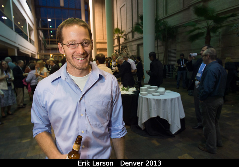 Erik Larson (University of Colorado) poses with a nice Colorado-brewed beverage.<br /> <br /> Credit: Henry Throop<br /> Oct 2013<br /> DPS45 Denver