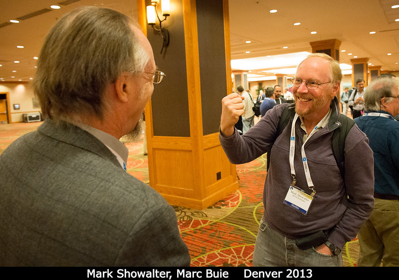 Mark Showalter (SETI) takes out a bit of small-body aggression on Marc Buie (SwRI).<br /> <br /> Credit: Henry Throop<br /> Oct 2013<br /> DPS45 Denver
