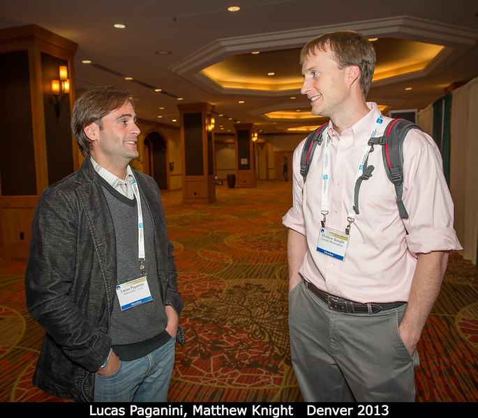 Lucas Paganini (GSFC / Catholic U) and Matthew Knight (Lowell) discuss.<br /> <br /> Credit: Henry Throop<br /> Oct 2013<br /> DPS45 Denver