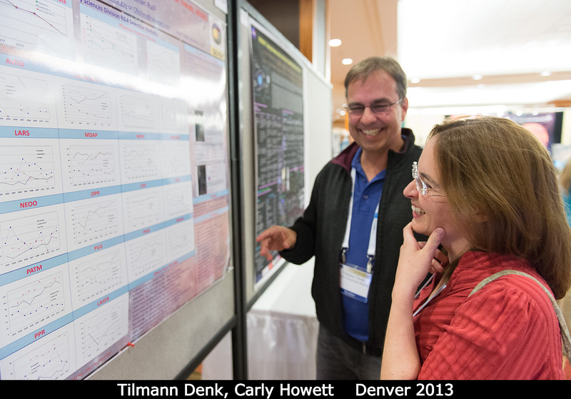 Tilmann Denk (Freie U, Germany) laughs as Carly Howett (SwRI) studies those dropping NASA R&A selection rates.  Credit: Henry Throop Oct 2013 DPS45 Denver