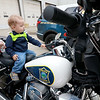 "Fitchburg Department of Public Works (DPW) held their annual DPW Day on Wednesday afternoon at their facility on Broad Street. The Police and Fire departments were on hand showing off cars and trucks as well. The Police even had a couple of their motorcycles. Orrin Schuller, 1, sits on one of the police motorcycles and could not stop saying ""Wow."" SENTINEL & ENTERPRISE/JOHN LOVE"