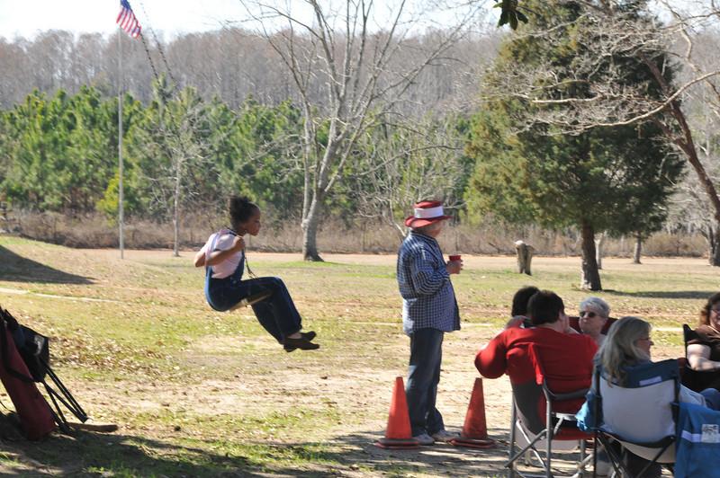 Michaela enjoys the swing