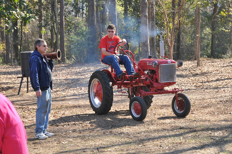 Thomas (48farmallcubteen) with his Dad and his tractor.