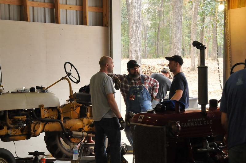 Matt, Tank and Mert discussing their next move on the brake repair