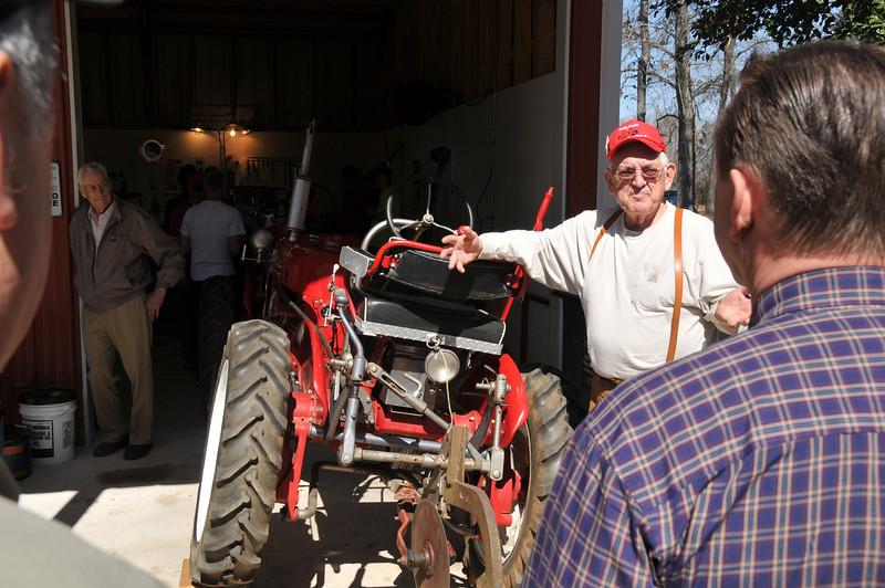 Bill Hudson begins his plow setup demo.  Bob McCarty looks on.