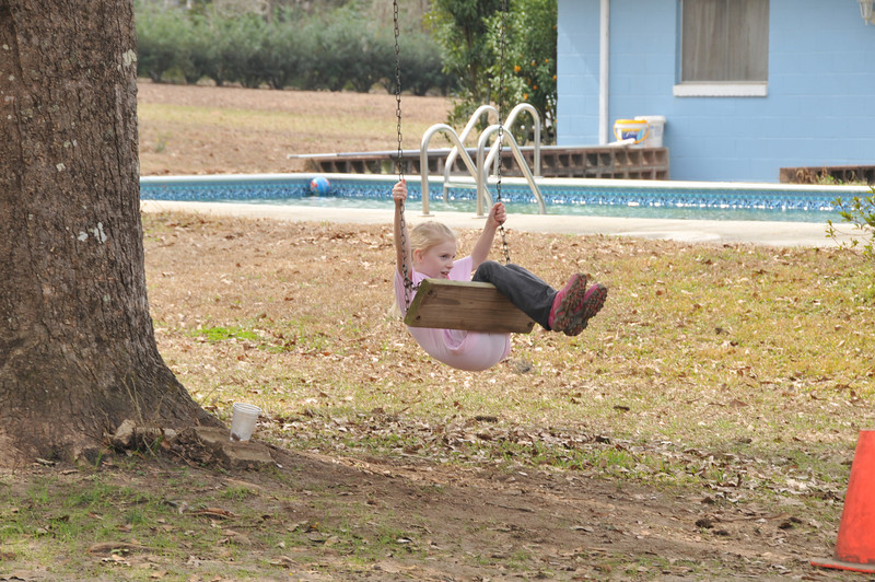 Leora takes a turn on the swing