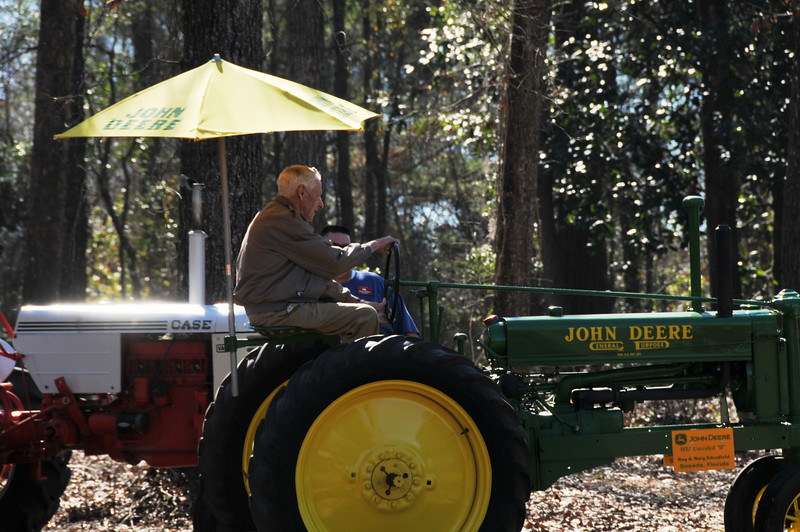 Mr. Harold driving a tractor like the one he grew up on.  He really enjoyed the ride.