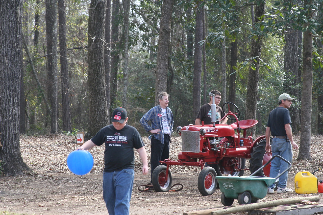 Court, JohnC, Thomas (48farmallcubteen) & his Dad standing with his tractor