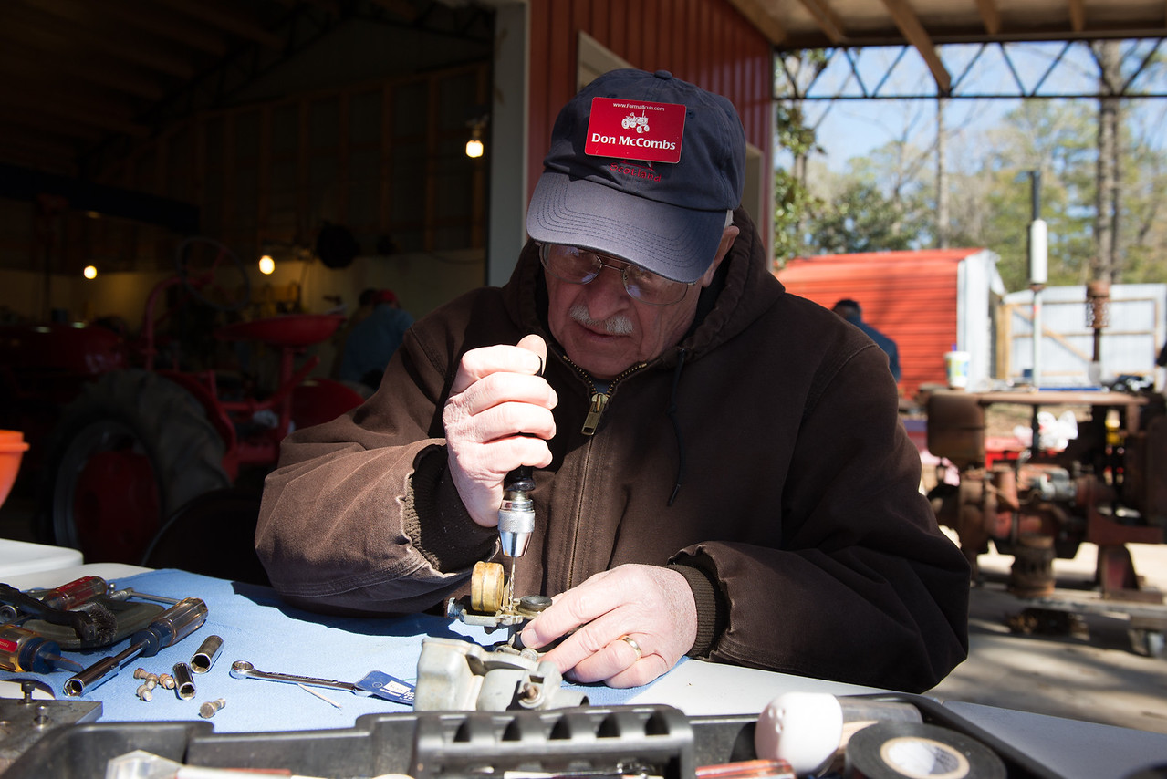Don McCombs repairing a cub carb