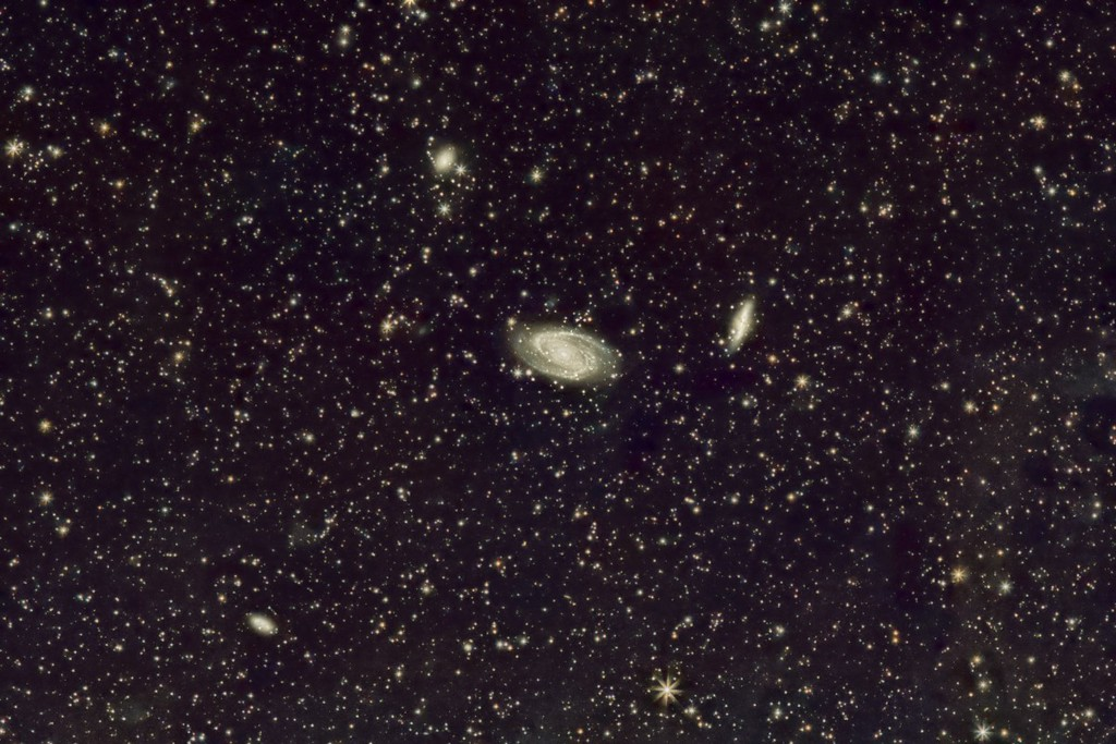 M81 (center) and M82 (nicknamed the Cigar Galaxy) in Ursa Major.  Plus a couple of other fuzzy galaxies!