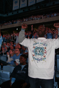New York state resident Jammie Mills is cheering for the North Carolina team at the Dean Dome on Monday. A passionate fan, he drove down from New York state to North Carolina to cheer for the Tar Heels.  Students and fans gathered in the Dean Dome and cheered as the North Carolina Tar Heels achieved victory against Michigan State on Monday night in NCAA championship.