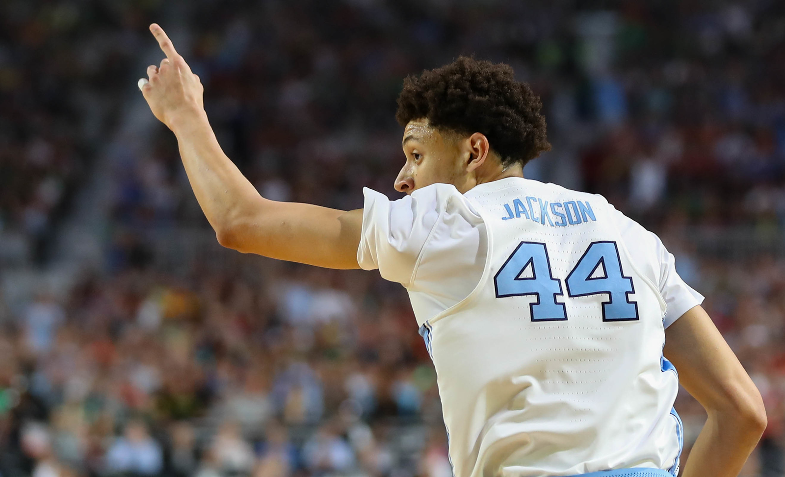 North Carolina wing Justin Jackson (44) points to the bench after hitting a 3-pointer against Oregon in the teams' Final Four matchup on Saturday in Phoenix.