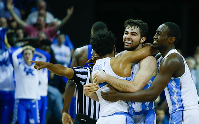 North Carolina forward Luke Maye (32) celebrates his game winning shot with guard Joel Berry (2) and Theo Pinson (1) in their Elite Eight matchup with Kentucky in Memphis on Sunday.