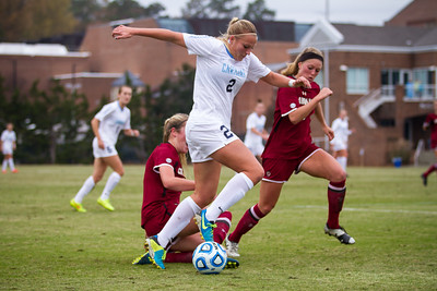 UNC forward Emily Bruder (2) runs the ball towards the goal.