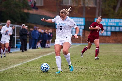 UNC forward Emily Bruder (2) runs the ball down the sideline.
