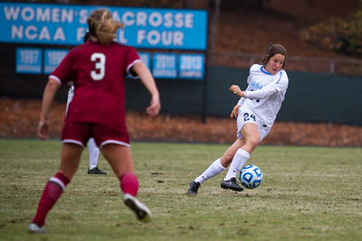 UNC forward Paige Nielson (24) runs the ball down the field.