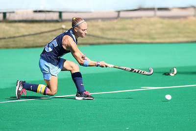 Abby Frey, a senior back, sweeps the ball into the circle during one of UNC's 10 penalty corners against Pacific.