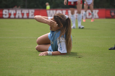 UNC's Brooke Elby (93) was carried off the soccer field due to a knee injury shortly into Sunday's game against North Carolina State University in Raleigh, NC.  The Lady Tar Heel's won 2-1 against the Lady Wolfpack.