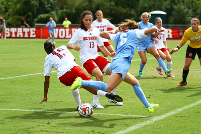 UNC Forward Summer Green (6) collides with NCSU Defender Alyson Brown.