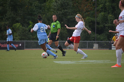 UNC's Jewel Christian (26) dribbled past NC State in Sunday's game against NC State University.  The Lady Tar Heels won 2-1 against NC State University.