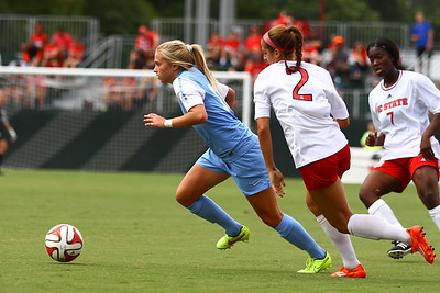 UNC Midfielder Megan Buckingham (18) breaks away from NCSU.