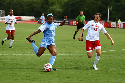 UNC Forward Amber Munerlyn (8) takes a shot during the second half.