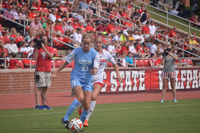 UNC's Cameron Castleberry (21) and NC State's Dayna Tomayko (2) battle for the ball at Sunday's soccer game in Raleigh, North Carolina. The Lady Tar Heel's won 2-1 against the Lady Wolfpack.