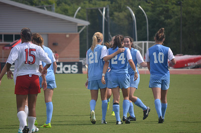 UNC's Paige Nielson (24) is congratulated by teammate Cameron Castleberry (21) after her goal at Sunday's soccer game against NC State University.  Nielson's goal was the second team goal for the Tar Heels. The Lady Tar Heel's won 2-1 against the Lad Wolfpack.