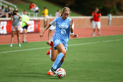 UNC Midfielder Cameron Castleberry (21) runs the ball down the field.